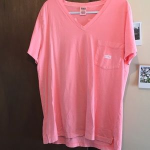 Pink short sleeve pocket shirt.